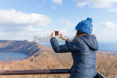 woman taking photo at outdoor
