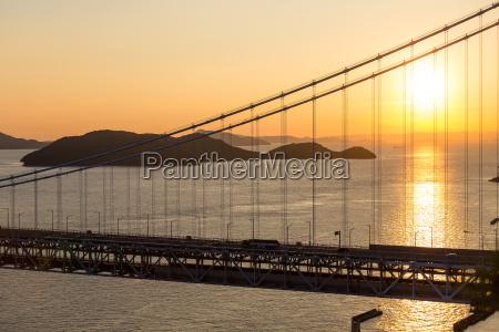 japanese great seto bridge at sunset