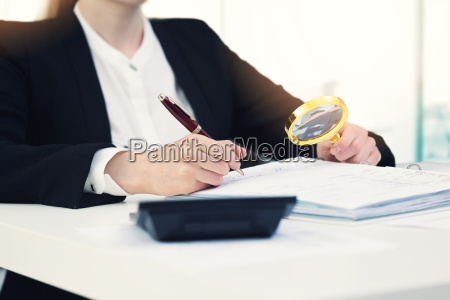 audit concept auditor with magnifying
