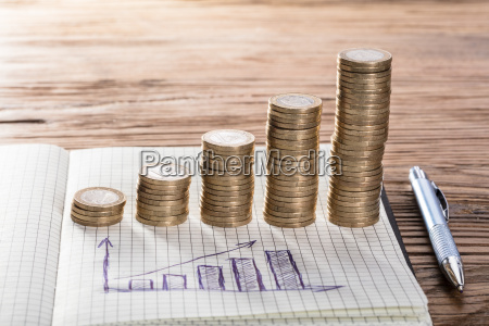 coin stacks with graph on notebook