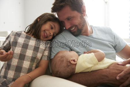 father with daughter and newborn son