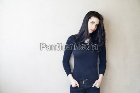 attractive young woman standing at a
