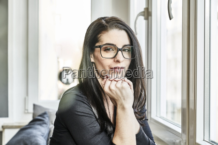 portrait of young woman with glasses