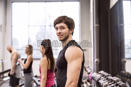 young people exercising in gym
