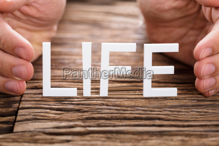 person protecting life text