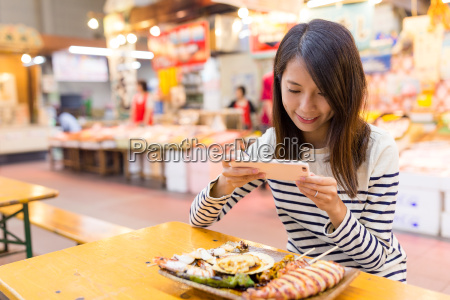 woman taking photo on her dish