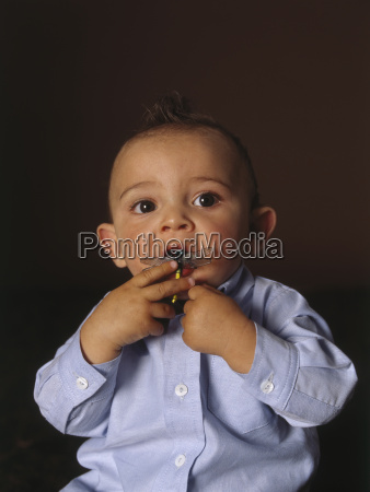 portrait of baby boy with toy