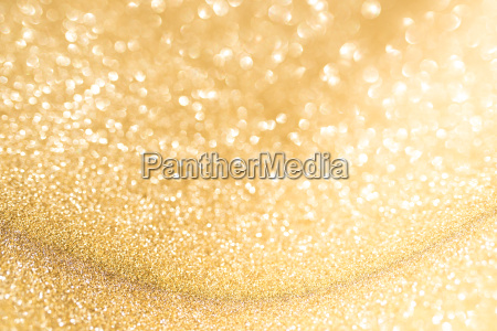 abstract golden background with bright bokeh