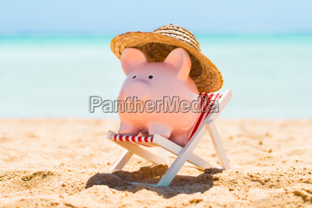 piggy bank with straw hat over
