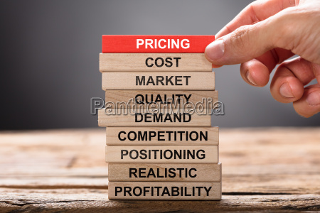 hand building pricing concept with wooden