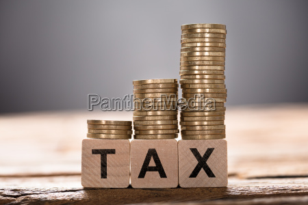 tax text written on wooden blocks