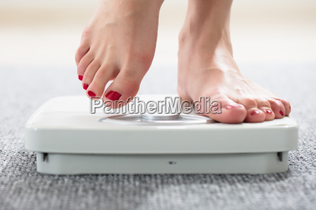 womans feet on scale