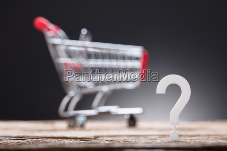 question mark with shopping cart in