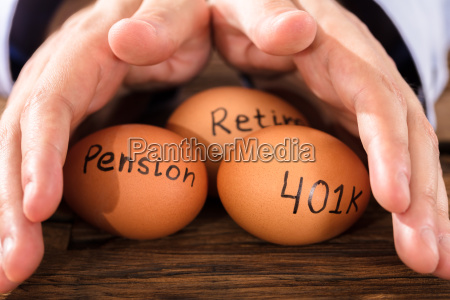 person protecting egg showing pension and
