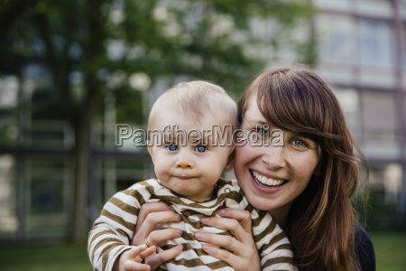 portrait of happy mother with her