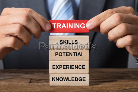 businessman building training concept with wooden
