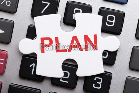 jigsaw puzzle piece with plan text